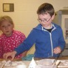 children enjoying pottery class